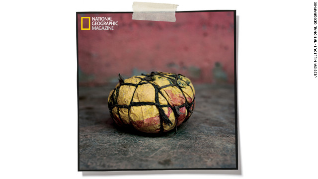 Bound with rope, plastic bags equal a ball in Bibiani, Ghana. Photographer Jessica Hilltout's<a href='http://ngm.nationalgeographic.com/2013/soccer-joy/hilltout-photography' target='_blank'> complete collection of soccer ball images</a> can be found in the February issue of National Geographic magazine.
