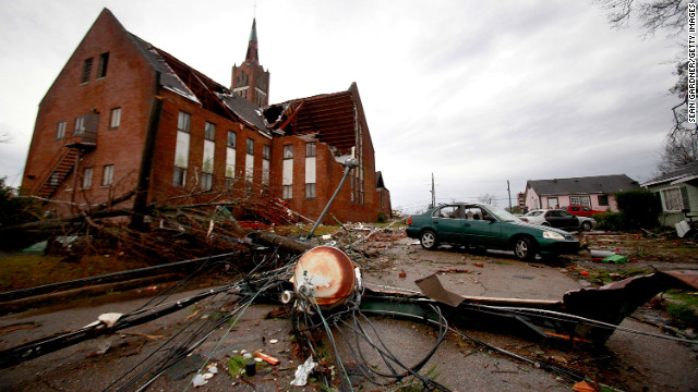 Power lines lie in the street near the roof-damaged Westminster Presbyterian Church on February 11 after a tornado ripped through Hattiesburg.