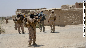 U.S. Marines from Kilo Company of the 3rd Battalion 8th Marines Regiment conduct a patrol in Garmser, Helmand Province on June 27, 2012. The 130,000 NATO troops are due to leave Afghanistan by the end of 2014 and there are fears that their exit will lead to a reduction in rights and freedoms in the war-torn country. AFP PHOTO / ADEK BERRY (Photo credit should read ADEK BERRY/AFP/GettyImages)