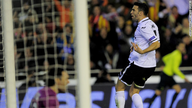 Valencia's Adil Rami pulled a goal back in the final minute to give his side a lifeline going into the second leg in France. The La Liga side had won all eight of its Champions League home against French opposition before Tuesday's defeat.