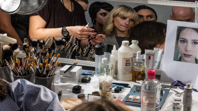 Makeup professionals pick up tips from visiting makeup artists backstage on February 12.