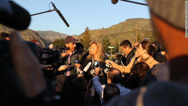 Cindy Bachman, information officers for the San Bernardino County Sheriff's Department, speaks to reporters at a roadblock near Big Bear Lake, California, on Tuesday, February 12. Christopher Jordan Dorner has been the subject of a massive manhunt and is accused of killing one police officer and wounding two others, as well as killing the daughter of his police union representative and her fiance on Sunday.