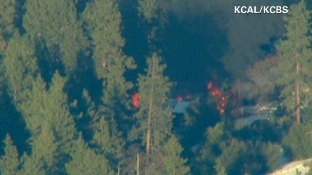 Authorities are working to identify a body found in a Big Bear Lake, California, cabin as manhunt suspect Christopher Dorner.