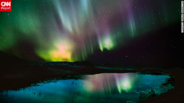 The Aurora Borealis, or Northern Lights, fill the sky with color above Iceland.