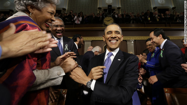 President Barack Obama is greeted before delivering his State of the Union address before a joint session of Congress on Capitol Hill in Washington on Tuesday, February 12.