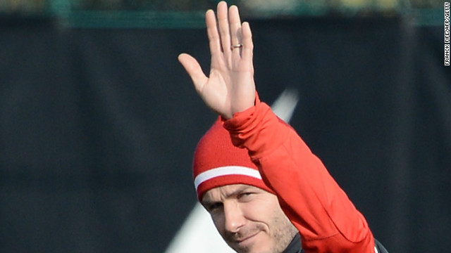 Beckham waves to the waiting press pack as he makes his way out at the club's Camp des Loges training center in Saint-Germain-en-Laye, near Paris. The session, which was led by PSG's Italian coach Carlo Ancelotti, was shown live on French television.