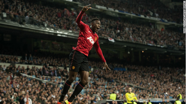 Welbeck dances away in celebration after firing United ahead, while most of the crowd look on in stunned silence.