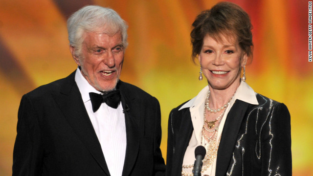 "Rob and Laura Petrie set the standard for many a sitcom marriage. You had two gifted comedians (Dick Van Dyke and Mary Tyler Moore) with chemistry to beat the band. Plus sitcom wives weren't expected to be sex symbols when ""The Dick Van Dyke Show"" first appeared in 1961. (Van Dyke here presents Moore with Screen Actors Guild honors for lifetime achievement in 2012.)"