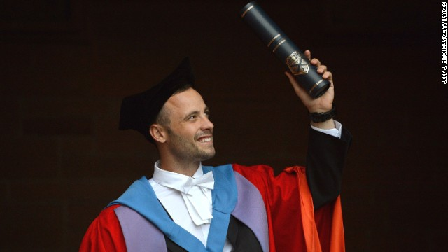 Pistorius waves after receiving his honorary doctorate from Strathclyde University on November 12 in Glasgow, Scotland.