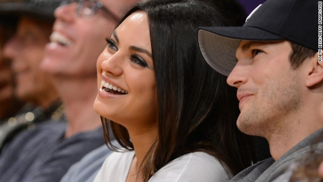 "The secret to Mila Kunis' relationship with Ashton Kutcher appears to be two-fold: Keep it private and casual. Neither star talks much about their romance, but on May 9 a pregnant Kunis revealed her fiance's sweet side. Kutcher's stocked a ""secondary fridge"" with foods she might crave, and is also learning Russian to speak to their baby."