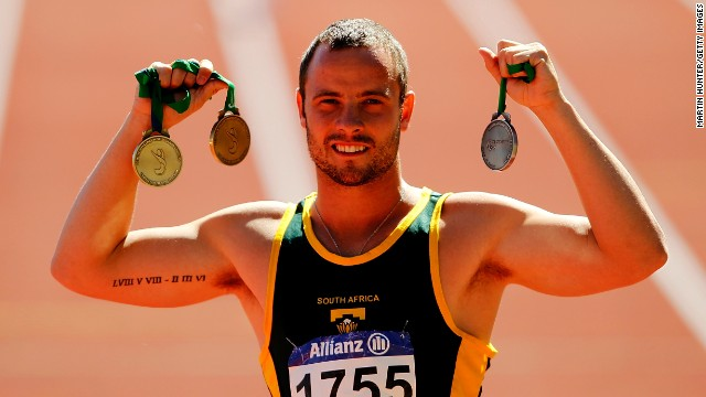 Pistorius poses with his medals from the IPC Athletics World Championships in January 2011. He won three world titles there