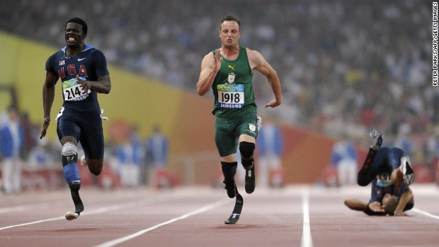 Pistorius runs to win gold ahead of Jerome Singleton, left, of the U.S. in the final of the 100-meter T44 as Marlon Shirley of the U.S. falls during the 2008 Beijing Paralympic Games on September 9, 2008. 