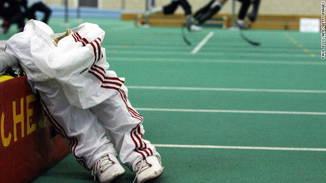 A pair of prosthetic legs stand on the ground as Pistorius coaches children at the Regional Arena, in Manchester, England, April 11, 2006.