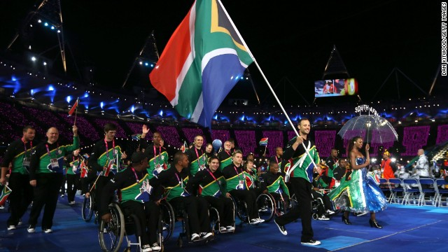 Pistorius carries the South African flag during the opening ceremony of the 2012 Paralympics in London.