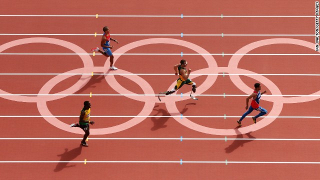 Pistorius, center, races in the men's 400-meter Round 1 heat in the London 2012 Olympic Games on August 4, 2012.