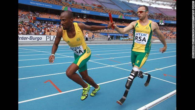 Pistorius passes the baton to Ofentse Mogawane in a 4x400-meter relay race during the IAAF World Athletics Championships in Daegu, South Korea, in September 2011. Pistorius was the first double amputee athlete to compete at the World Athletics Championships.