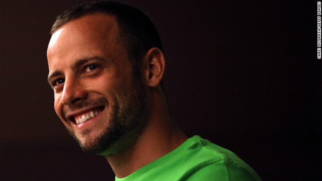 Pistorius speaks with Olympic gold medalist Michael Johnson of the United States during a media gathering prior to the 13th IAAF World Athletics Championships Daegu 2011 on August 26, 2011, in Daegu, South Korea. Pistorius was the first amputee athlete to compete at the World Athletics Championships.