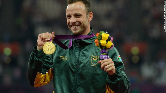 Pistorius poses on the podium with his gold medal after winning the men's 400-meter T44 final at the 2012 Paralympic Games.