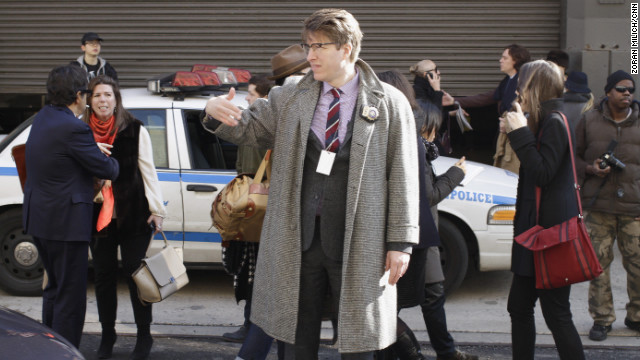 NYPD community affairs detective Rick Lee, also known as the &quot;Hipster Cop,&quot; directs traffic.