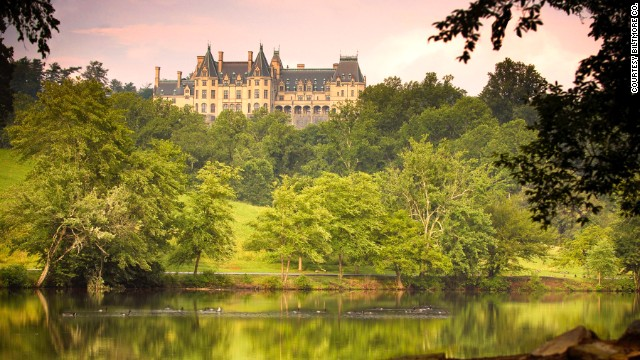 A view of the Biltmore estate from the lagoon shows the back of the house.