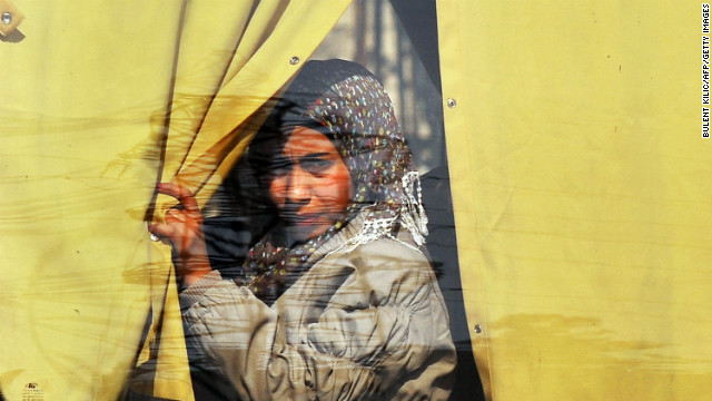 A Syrian woman looks through a bus window in Aleppo on February 14.
