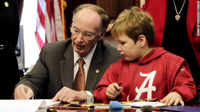 Ethan draws with Gov. Bentley in his office on Feb. 13.