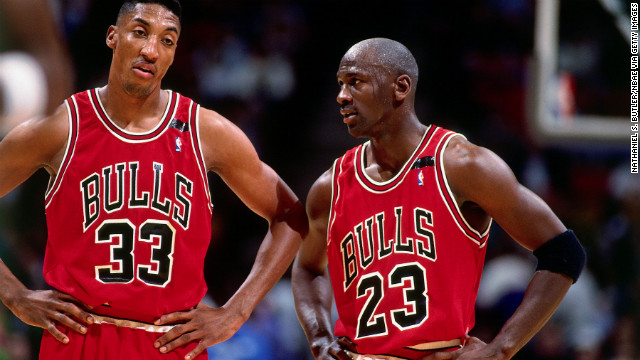 Jordan talks with teammate Scottie Pippen during a game against the Philadelphia 76ers in 1992.