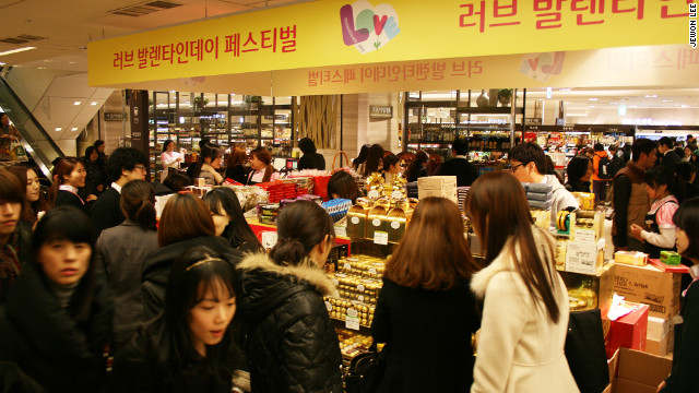 Seoul women line up to buy chocolates for men for Valentine's Day. 