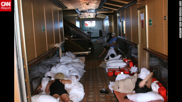 Passengers lie on beds in a hallway aboard the Carnival Triumph.