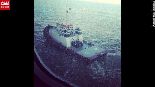 &quot;One of two tugboats pulling us through the channel to Mobile, Alabama, along with a channel guide boat,&quot; writes Maclaskey. The ship is being towed slowly to Mobile, Alabama, and is expected to port late February 14.