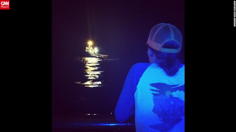 &quot;Mike watching the first tugboat setting up to pull us,&quot; writes Chase Maclaskey on Instagram. The 4,229 passengers and crew aboard the Carnival Triumph have been stuck on the ship since fire disabled the vessel on Sunday, February 10. Click through to see passengers' photos from on board.