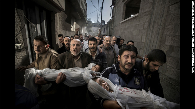 &lt;strong&gt;World Press Photo of the Year: &lt;/strong&gt;Suhaib Hijazi, 2, and his brother, Muhammad, 3, were killed when an Israeli airstrike struck their Gaza City house, photographer Paul Hansen said. Their father, Fouad, was also killed, Hansen said. In the photo, Fouad's brothers carry the children's bodies to a mosque for burial on November 20, 2012, while the father's body follows behind on a stretcher. The following are a selection of the other World Press Photo winners: