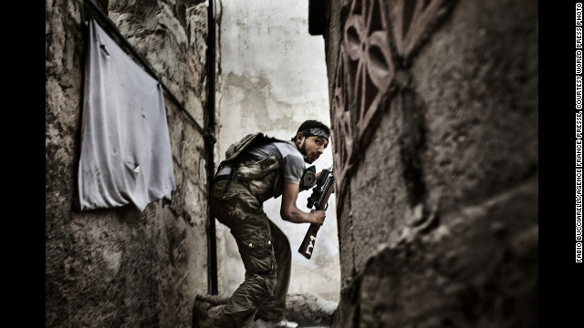 <strong>Second prize -- spot news stories: </strong><!-- --> </br>A Free Syrian Army fighter during clashes against government forces in Aleppo, Syria, on October 10, 2012.