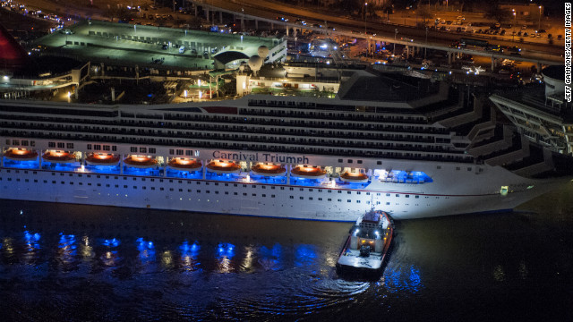 The crippled cruise liner Carnival Triumph limps into port late Thursday, February 14, in Mobile, Alabama. Passengers had endured five days aboard the stricken ship with little power and few toilet facilities after a fire knocked out propulsion and other systems on Sunday, February 10. 