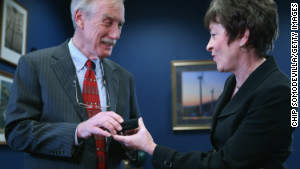 Sen. Susan Collins, R-Maine, presents Sen.-elect Angus King with Senate cufflinks in Collins\' Capitol Hill office.