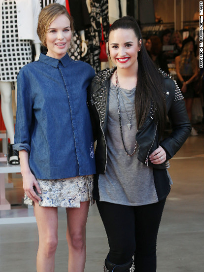 Kate Bosworth and Demi Lovato attend a store opening in Los Angeles.