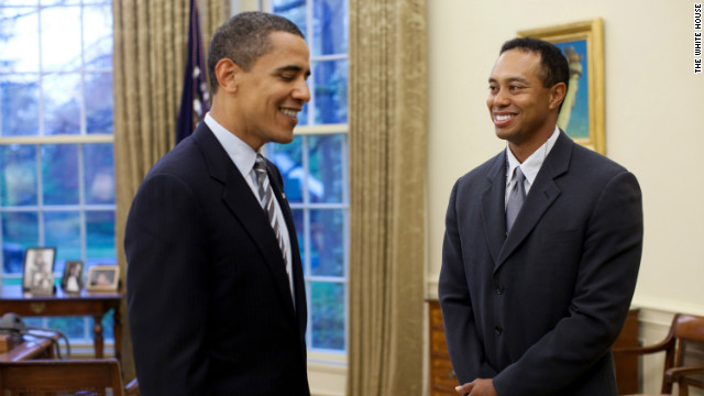 Obama tees off with Tiger Woods
