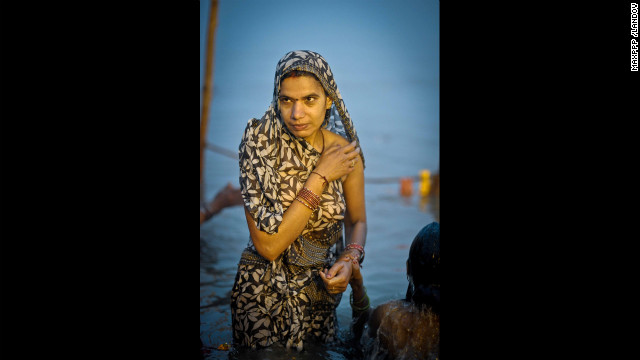 A woman rises out of the Sangam on February 17.