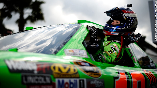 Patrick gets out of her car after qualifying for the Daytona 500 in 2012.