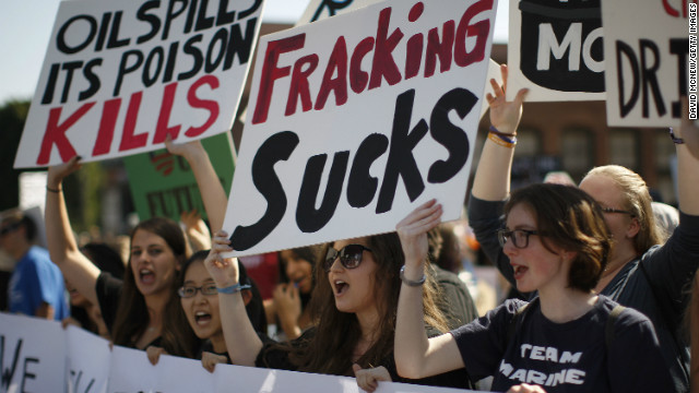 Environmental activists march Sunday in Los Angeles in a protest coordinated with a rally in Washington against climate change.