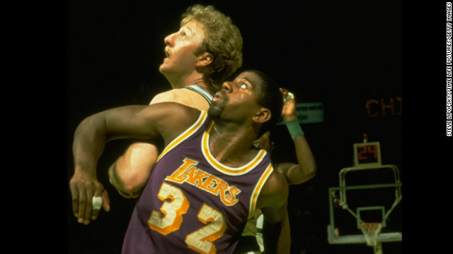 After the Lakers' first championship under Buss, either the Lakers or Boston Celtics played in the next four championship series. The Celtics won the 1984 championship in seven games, reigniting a storied rivalry between the two teams that had waned after the championship contests of the 1960s. Pictured, &quot;Magic&quot; Johnson and the Boston Celtics' Larry Bird in the NBA Finals in 1984.