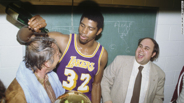 The Lakers won their first of 10 championships under Buss. Veteran center Kareem Abdul-Jabbar averaged a monstrous 32 points, 13 rebounds and four blocks during the playoffs, but he had to share the stage with a 20-year-old rookie who would soon become a legend himself, Earvin &quot;Magic&quot; Johnson. Pictured, Johnson dumps champagne on Buss after winning a game in the 1980 series. 
