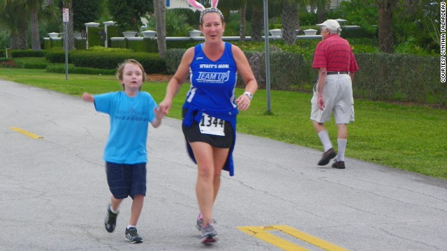 Cynthia Falardeau and her son Wyatt, who had part of his right arm amputated as a newborn, run a race for autism awareness.
