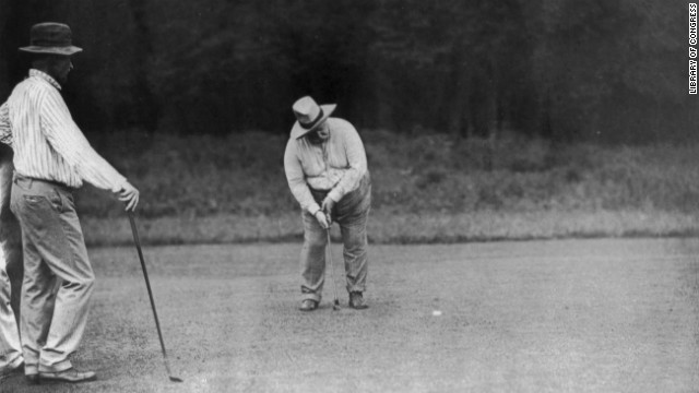 President William Howard Taft, the 27th U.S. president, putts on the green in Chevy Chase, Maryland, on June 28, 1909. He is said to be the first presidential golfer.