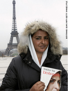 Mai wrote a book about her experience that was published in 2006. It has since been translated into 23 languages. Here she is seen posing with the French edition outside the Eiffel Tower in Paris.