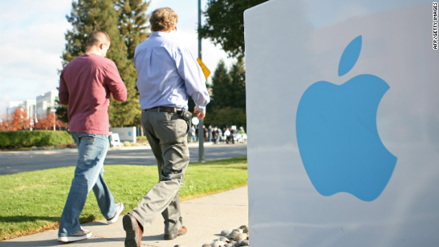 Employees stroll on Apple's campus in Cupertino, California. The company says a small number of its computers were hacked.
