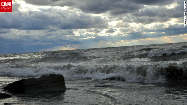 "Pam Jenkins often walks her dog along the Lake Erie beach near her home in Perry, Ohio. On a stormy September Sunday, they went hoping to see a water spout. ""No luck, but the surf and sky was amazing,"" she says."