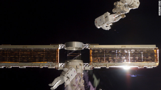 The Space Shuttle Endeavour crew, on mission STS-97, installs the first set of U.S. solar arrays on the station in 2000.