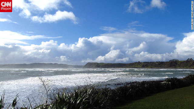 "After Cindy Schultz captured this image of clear skies and calm water at Raglan Beach, New Zealand, the weather dramatically changed before her eyes. ""Blue skies and white puffy clouds gave way to dark skies and black clouds within a matter of minutes,"" she says. ""It was beautiful, whether the water was blue or gray."""