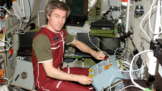 Cmdr. Sergei Krikalev tests new hardware in anticipation of the unmanned cargo ship Jules Verne in 2008.
